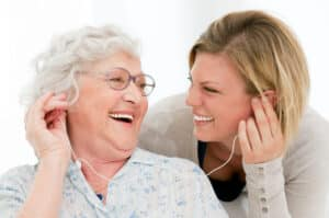 Excited grandmother listening music