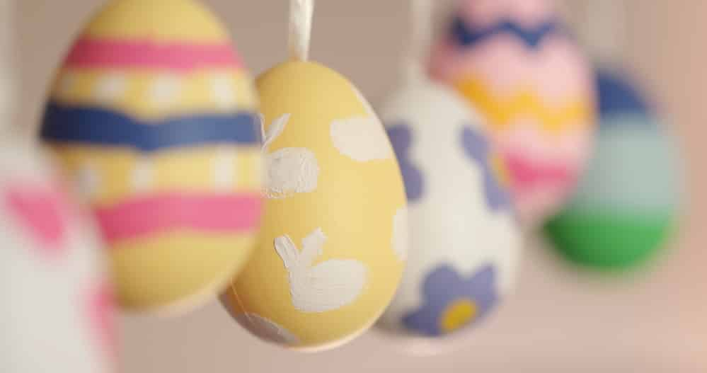 Colorful painted easter eggs hanging, selective focus